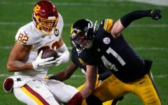 PITTSBURGH, PENNSYLVANIA - DECEMBER 07: Logan Thomas #82 of the Washington Football Team looks to gain yardage agaisnt Robert Spillane #41 of the Pittsburgh Steelers during the second quarter of their game at Heinz Field on December 07, 2020 in Pittsburgh, Pennsylvania. (Photo by Justin K. Aller/Getty Images)