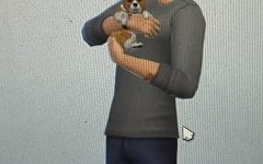 A Sim man who looks strangely like Jack Manifold because Sims 4 random generation is weird, holding a small puppy.